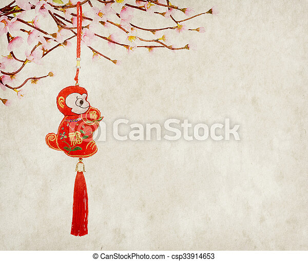 Chinese lunar new year ornaments toy of monkey on festive background - csp33914653