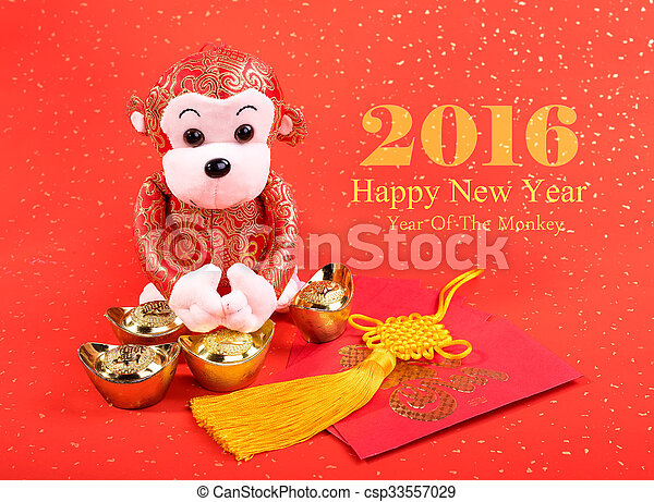 Chinese lunar new year ornaments toy of monkey on festive background - csp33557029