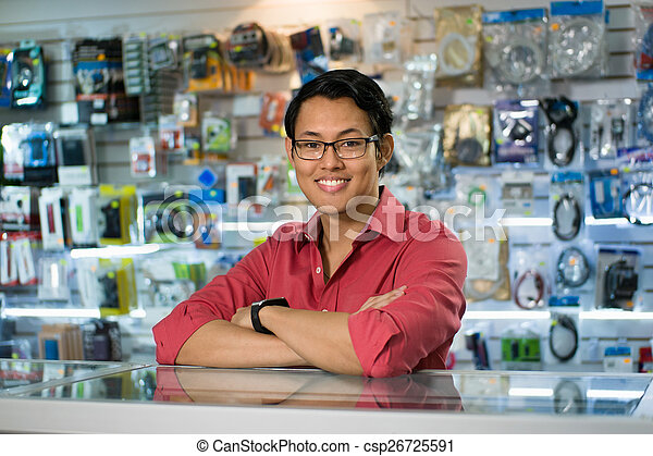 Chinese Man Working As Clerk Sale Assistant In Computer Shop - csp26725591