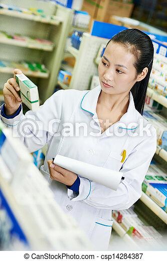 Chinese pharmacy chemist woman in china drugstore - csp14284387