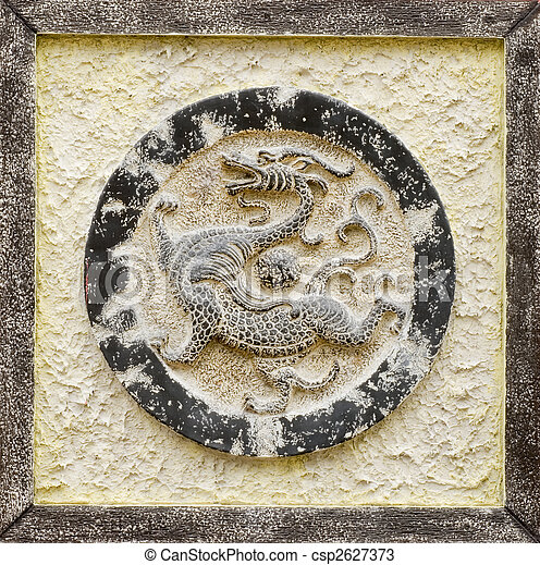 Chinese religious stone carving of dragon - csp2627373