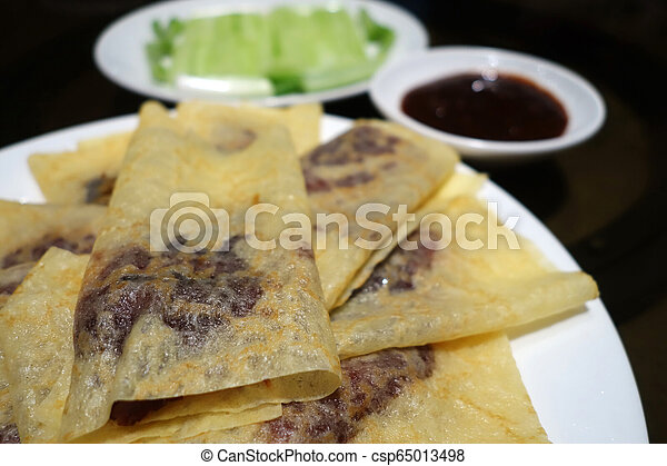 Chinese roast duck wapped in pancakes - csp65013498
