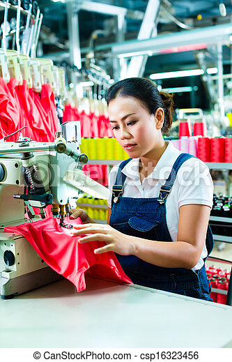 Chinese seamstress in a textile factory - csp16323456