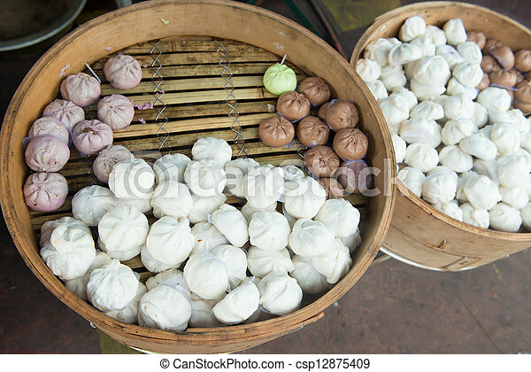 chinese steamed buns in traditional bamboo steamer