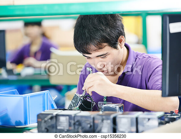 chinese worker at manufacturing - csp15356230