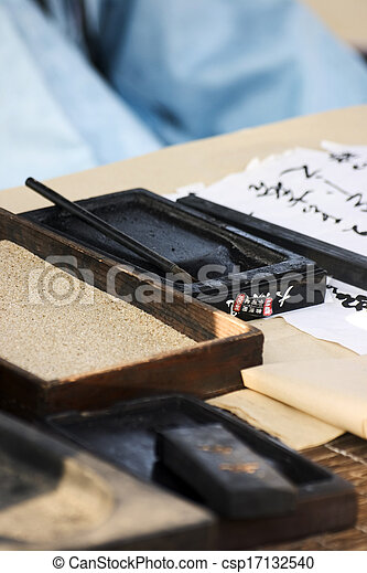 Chinese writing brushes and inkstone on the table - csp17132540
