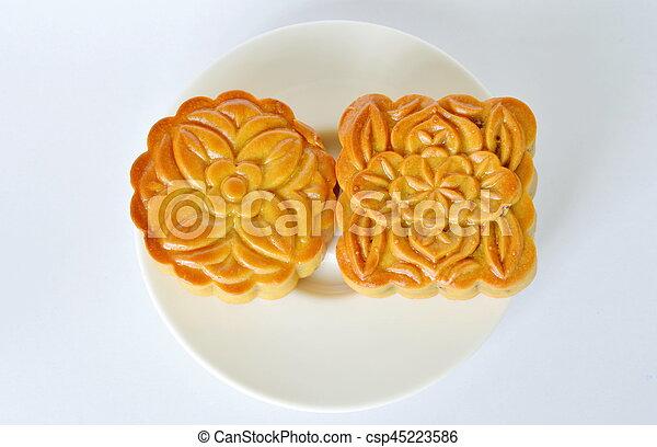 Pastel de Luna postre tradicional chino en festival en plato - csp45223586