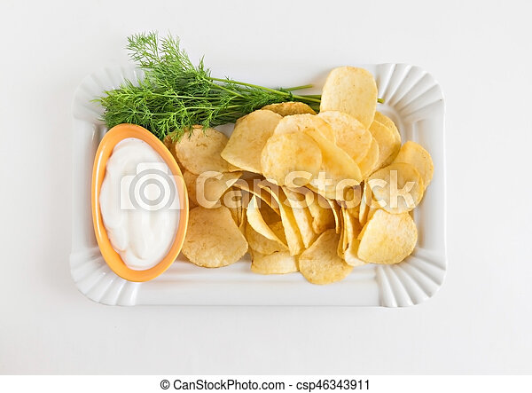 chips with sour cream and dill sauce isolated - csp46343911