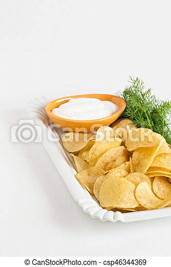 chips with sour cream and dill sauce isolated - csp46344369