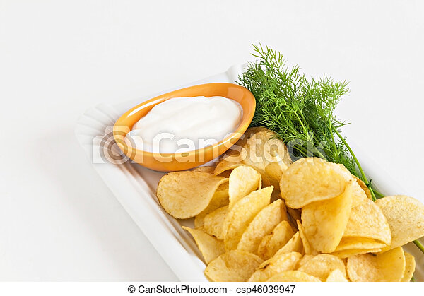 chips with sour cream and dill sauce isolated - csp46039947