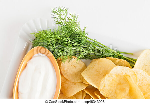 chips with sour cream and dill sauce isolated - csp46343925