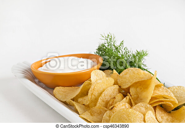chips with sour cream and dill sauce isolated - csp46343890