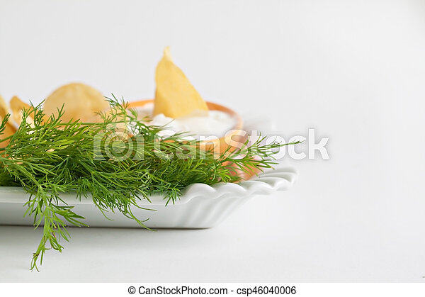chips with sour cream and dill sauce isolated - csp46040006