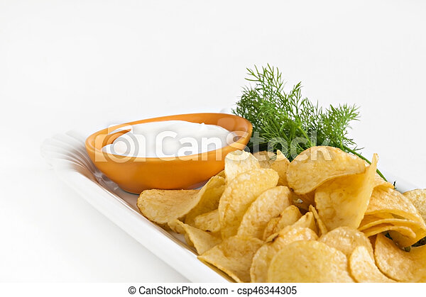 chips with sour cream and dill sauce isolated - csp46344305