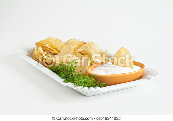 chips with sour cream and dill sauce isolated - csp46344035