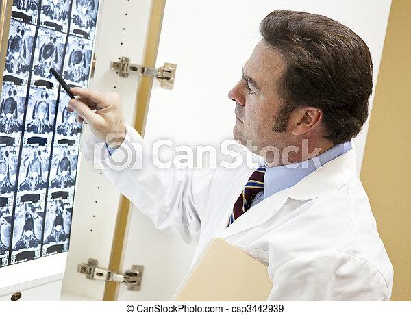 Chiropractor Examines CT Scan - csp3442939