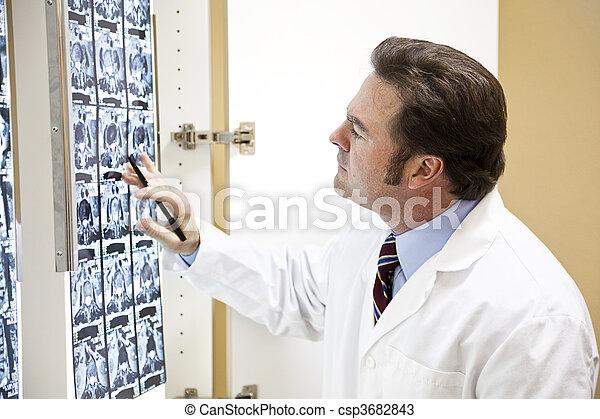 Chiropractor Examines Scan - csp3682843