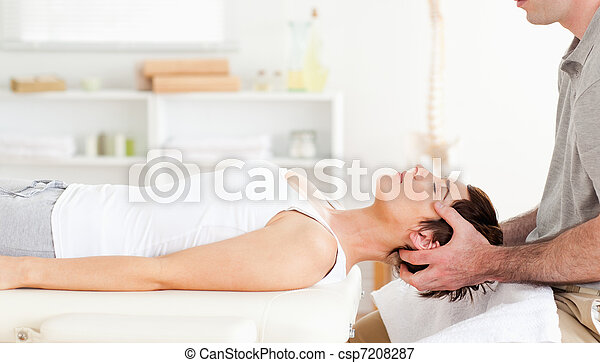 Chiropractor stretching a cute woman - csp7208287
