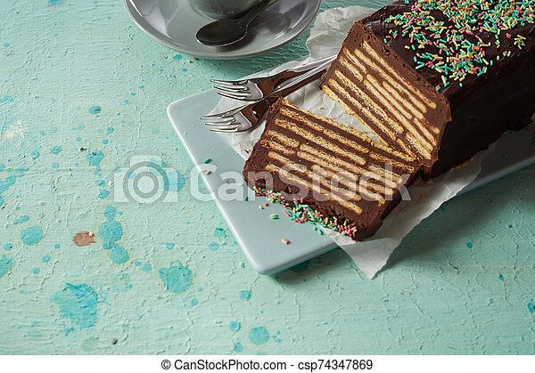 Chocolate biscuit cake with topping - csp74347869