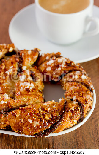 chocolate bretzel with cup of coffee - csp13425587