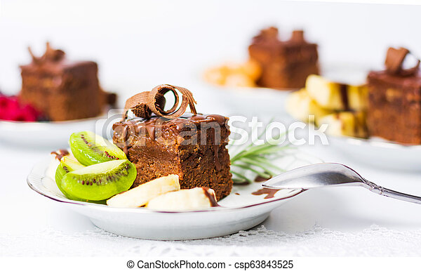 Chocolate cake with fruit on a plate - csp63843525