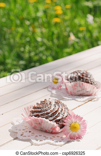 Chocolate cakes on the table in the garden - csp6926325