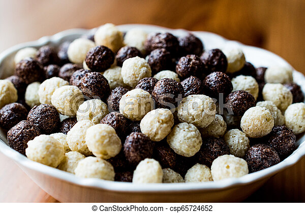 Chocolate Cereal balls in bowl. - csp65724652