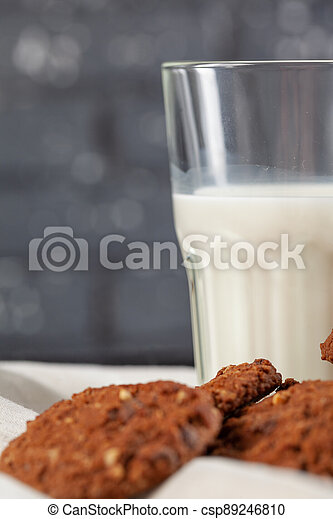Chocolate crispy cookies with glass of milk close up - csp89246810