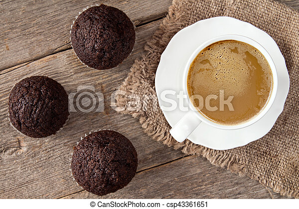 Chocolate cupcakes and cup of cappuchino - csp43361651