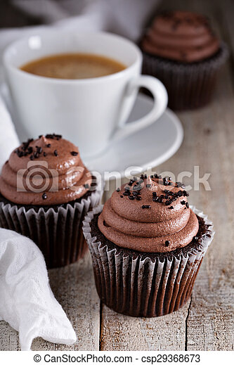 Chocolate cupcakes with a cup of coffee - csp29368673