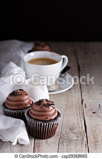 Chocolate cupcakes with a cup of coffee - csp29368665