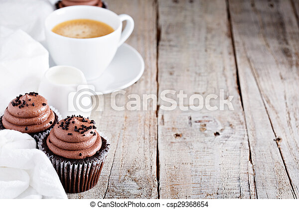 Chocolate cupcakes with a cup of coffee - csp29368654