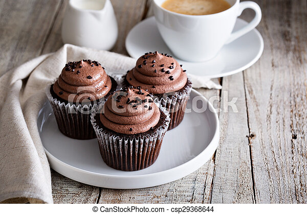 Chocolate cupcakes with a cup of coffee - csp29368644
