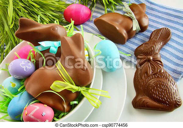 Chocolate Easter bunny and eggs on kitchen counter - csp90774456