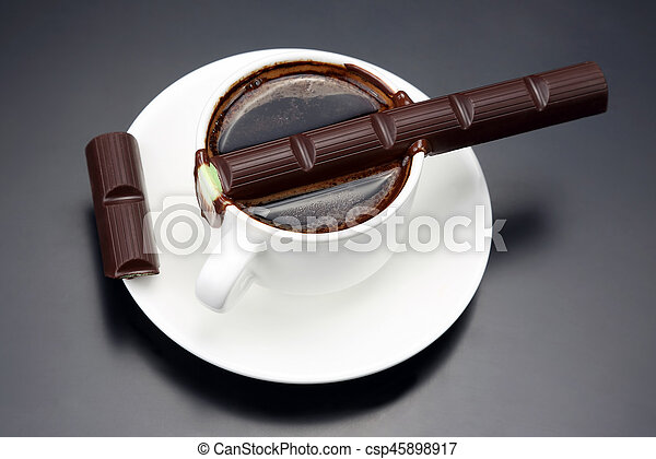 chocolate melted on white hot Cup with black coffee - csp45898917