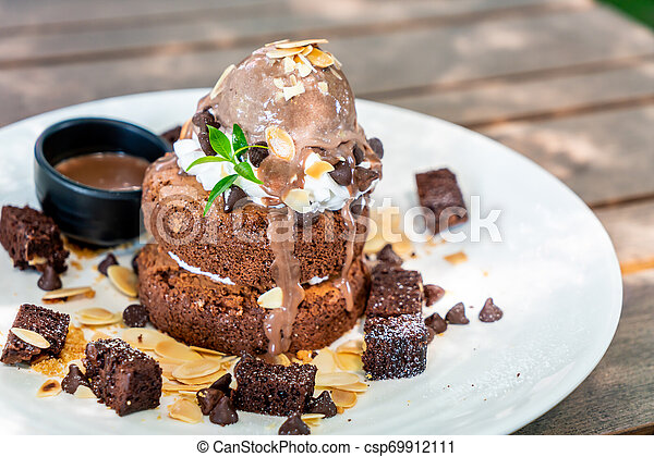 Chocolate Pancake With Chocolate Ice Cream And Brownies On White Plate Canstock