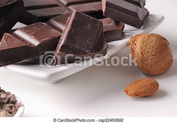 Chocolate portions with almonds on a dish close up - csp32450692
