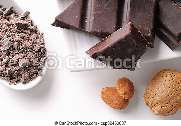 Chocolate portions with almonds on a dish close up - csp32450637