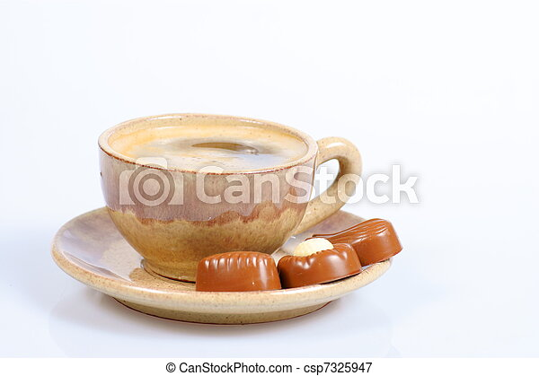 chocolate pralines cup with black coffee on white - csp7325947