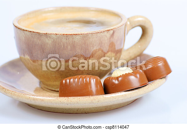 chocolate pralines cup with black coffee on white - csp8114047