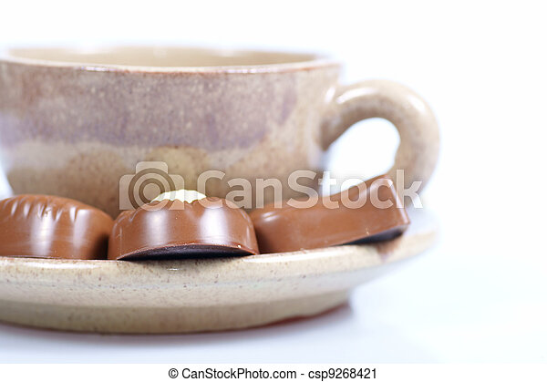 chocolate pralines cup with black coffee on white - csp9268421