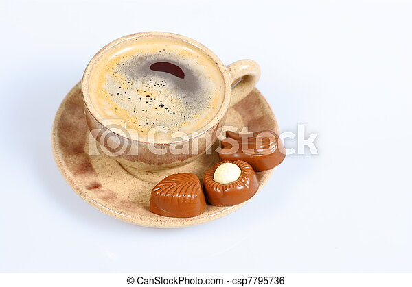 chocolate pralines cup with black coffee on white - csp7795736