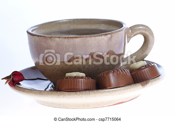 chocolate pralines cup with black coffee on white - csp7715064