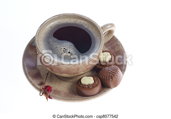 chocolate pralines cup with black coffee on white - csp8077542