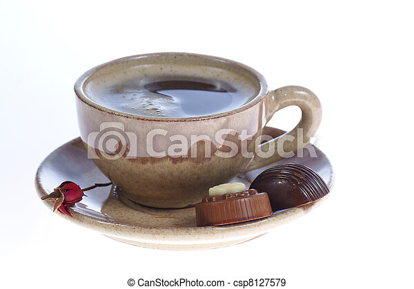 chocolate pralines cup with black coffee on white - csp8127579