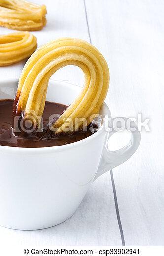 chocolate quente, churros., espanhol - csp33902941
