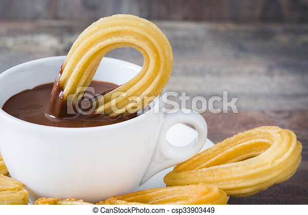 chocolate quente, churros., espanhol - csp33903449