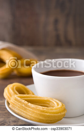 chocolate quente, churros., espanhol - csp33903071