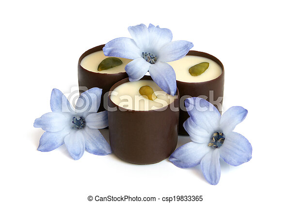 Chocolate sweets with blue flowers of hyacinth - csp19833365