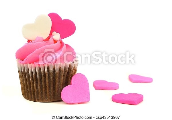 Chocolate Valentines Day cupcake with pink frosting and hearts - csp43513967